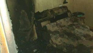 Сгоревший диван - фото