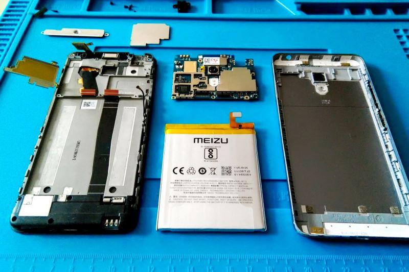 услуги по ремонту телефонов - фото